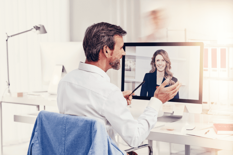 Signia-Nx_man-video-chat-computer-prev