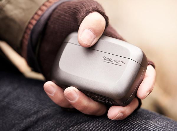 man_holding_rechargeable